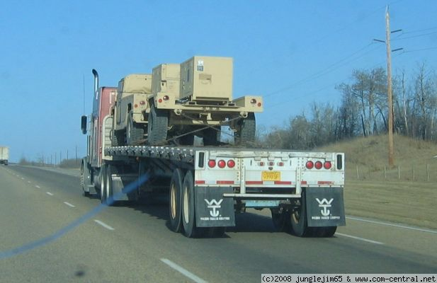 Click to view full size image  ==============  Humvee on the road 1